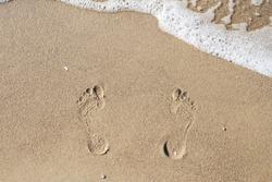 Footprints in the sand. Sea. Ocean. The waves.