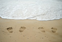 Footprints of couple on outdoor beach sand