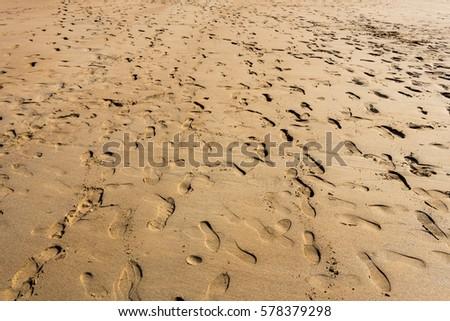 Footprints on a very busy beach