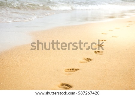 Footprints on beach close up background.