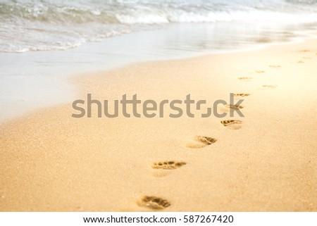 Footprints on beach close up background.