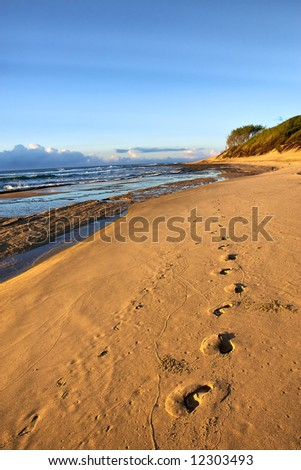 Footprints on beach in sunrise light. Shot in Sodwana Bay Nature Reserve, KwaZulu-Natal province, Southern Mozambique area, South Africa.