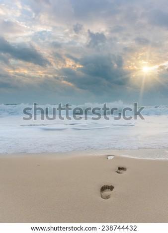 Footprints on the beach in Koh Samui Thailand