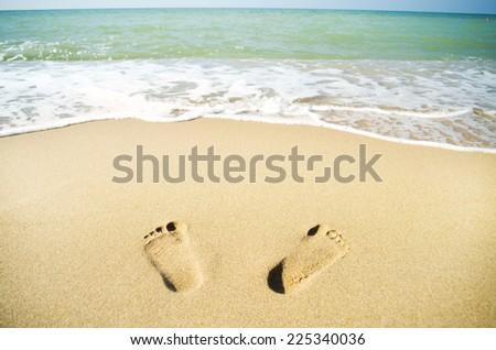 Footprints on the beach sand.Traces on the beach.