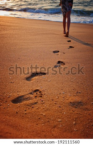 Footprints on the beach sand.Traces on the beach. Footsteps on the beach by the sea in summer