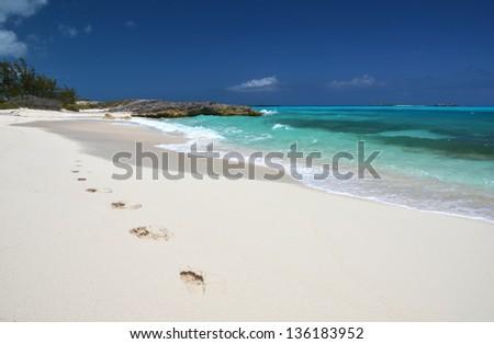 Footprints on the desrt beach of Little Exuma, Bahamas