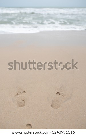 2ae870c1c Footsteps fade on the sand at the beach.  1240991116