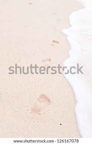 Footsteps in the sandy beach