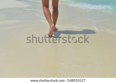 footsteps on beautiful white sand beach at summer vacation #168810527