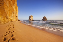 Footsteps on the beach at the Twelve Apostles along the Great Ocean Road, Victoria, Australia. Photographed at sunset.