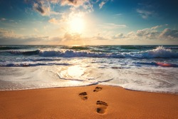 Footsteps on the beach,  sunrise shot.