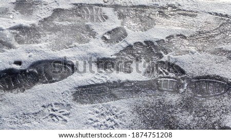 Footwear traces on icy surface stock photo