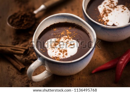 For better humor. A delicious and aromatic cup of hot chocolate with velvet coconut cream, enriched with chilli.
