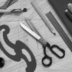 for cutting fashionable clothes, a paper pattern, tailor's scissors, a pattern, a ruler, a pencil and fabric are prepared