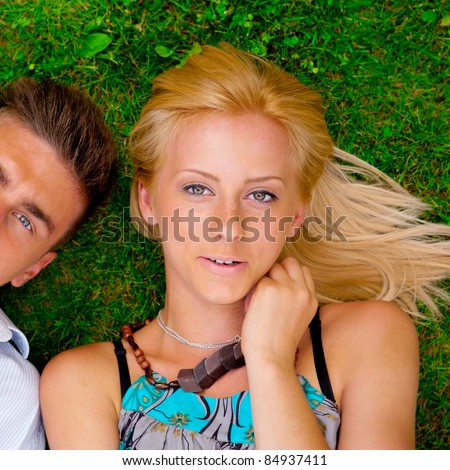 For every single pretty girl is tending her boyfriend. A portrait of a sweet couple in love. Photo from above. Square.