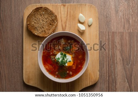 For lunch it is always useful to eat soup with bread. #1051350956