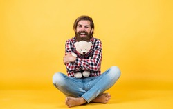 for me. This is for you. hipster like animal toy. Birthday holiday party celebration. feel happiness. Man with beard hold cute toy bear. Man holds teddy bear. Gifts and holidays concept