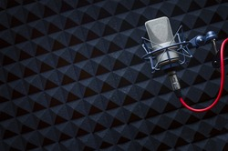 For radio stations and podcasts: background with professional microphone