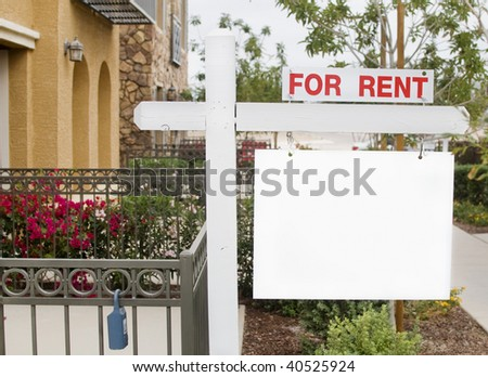 For Rent real estate sign outside homes - stock photo