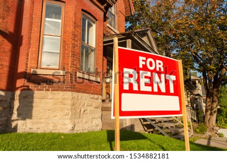For rent sign posted in front of front porch