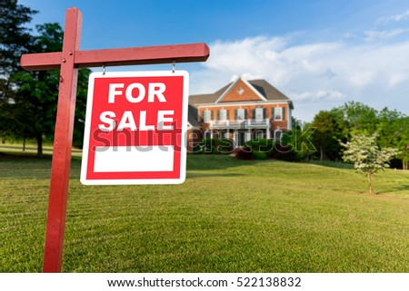 For Sale realtor sign in front of large brick single family house in expansive grass yard for real estate opportunity #522138832