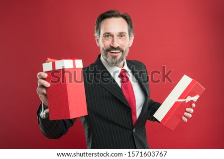 For you. Happy businessman give presents red background. Mature man smile with presents. Birthday presents. Boxing day. Gift wrapping. Wrap your presents. Welcome to holiday.