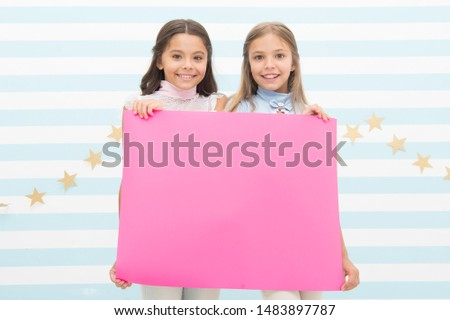 For your text. Happy children holding empty sheet of paper. Little children smiling with pink drawing paper. Small children with blank advertisement poster. Cute children advertising, copy space. #1483897787