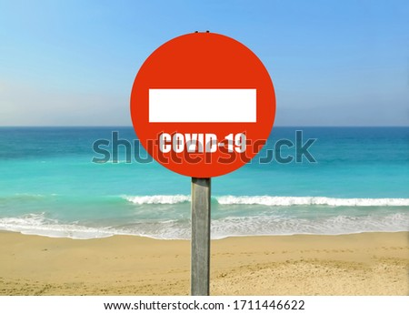 Forbidden sign, prohibition signal at the beach, Spain. Coronavirus and travels Tourism industry. Tourists stop travel, vacations cancelled because of COVID-19 pandemic, the tourism crisis.