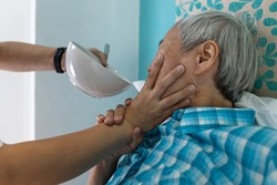 Force-feeding,Asian senior woman refuses,does not want to eat food,caregiver scolding,forcing the elderly to eat,old people with no appetite,stop physical abuse,violence,aggression,coercion concept