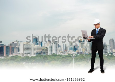 Fore man looking for building from laptop