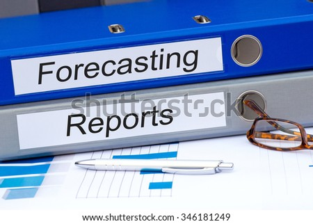 Forecasting and Reports - two binders with text on desk in the office #346181249