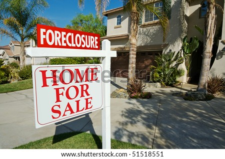 Foreclosure For Sale Real Estate Sign in Front of Beautiful New Home stock photo