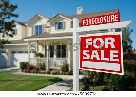 Foreclosure Home For Sale Real Estate Sign in Front of New House. stock photo