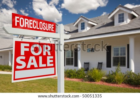 Foreclosure Home For Sale Real Estate Sign in Front of New House - Left Facing. stock photo