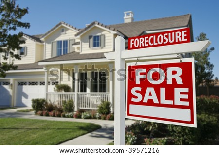 Foreclosure Home For Sale Sign in Front of Beautiful House. stock photo