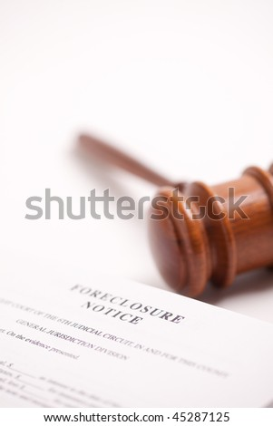 Foreclosure Notice and Gavel on Gradated Background with Selective Focus.