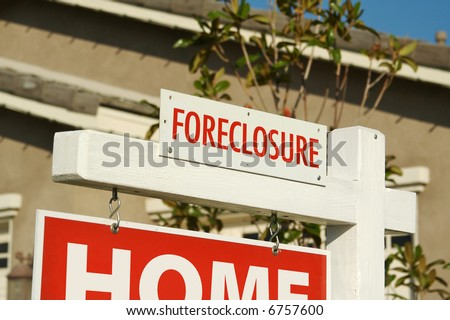 Foreclosure Real Estate Sign in Front of House.