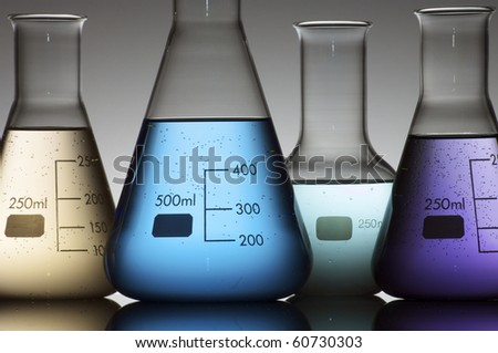 forefront of a chemical laboratory flasks containing liquid shiny