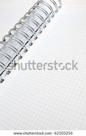 forefront of a spiral notebook with graph paper