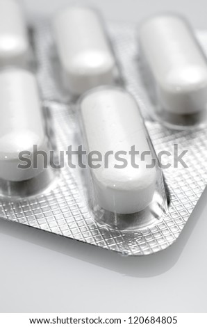 forefront of a white medicine pills in blister pack