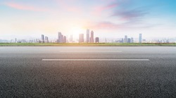 Foreground highway asphalt pavement city building commercial bui