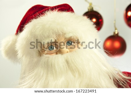 foreground of the face of a Santa Claus toy