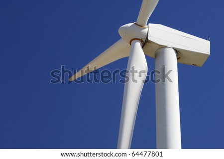 foreground of the top of a windmill for renewable electric energy production