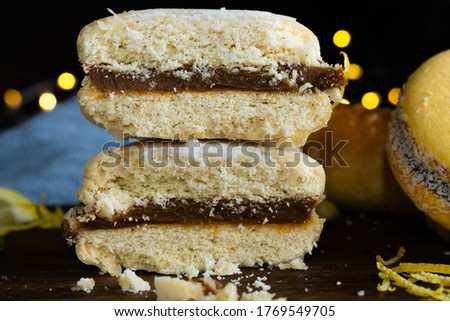foreground typical cordoba caramel cookie from Argentine and cornstarch from pastry maker lemon mint and croissant on wood with dark background Photo stock ©