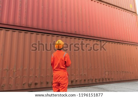 Foreman check security and safety  for the best shipping of cargo in the container yard port concept transportation freight shipping.