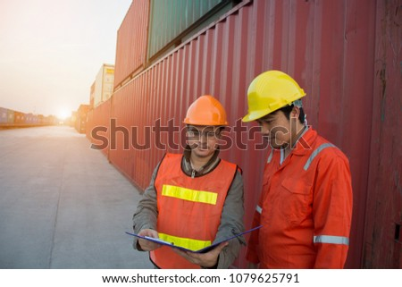 Foreman check security and safety with note book for the best shipping of cargo in the container yard port concept transportation freight shipping.