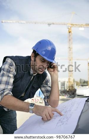 Foreman checking plan