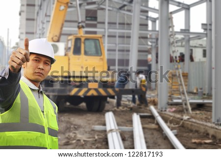 foreman construction site with construction background and worker