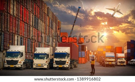 Foreman control and check list with walky-talky for loading Containers box to truck, Container ship in import export. Trade Port. Shipping, cargo to harbor Business logistic concept