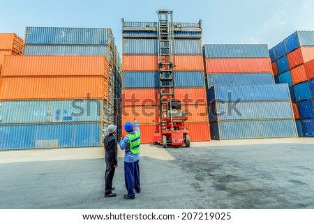 foreman control forklift handling follow order from his manager for move the container box loading at dock yard